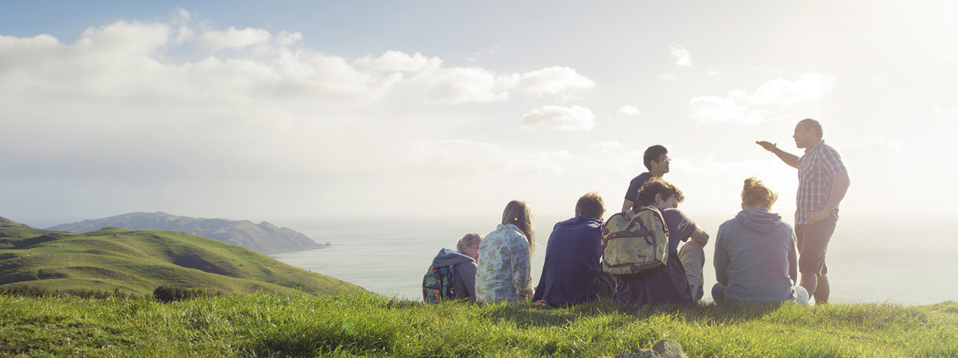 Group of people talking overlooking a the sea